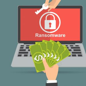thumbnail for ransomware - a graphic of a key being swapped for money over a locked laptop